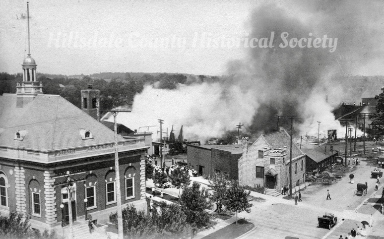"A 1913 fire said to have been built by ""bums"" along the railroad tracks. The hillsdale [ost office is ony a couple years old in this picture."