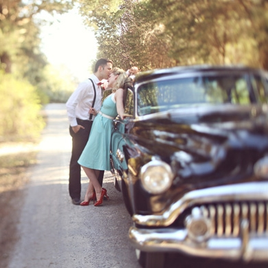 couple-near-vintage-car-in-retro-styled-engagement-shoot.jpg