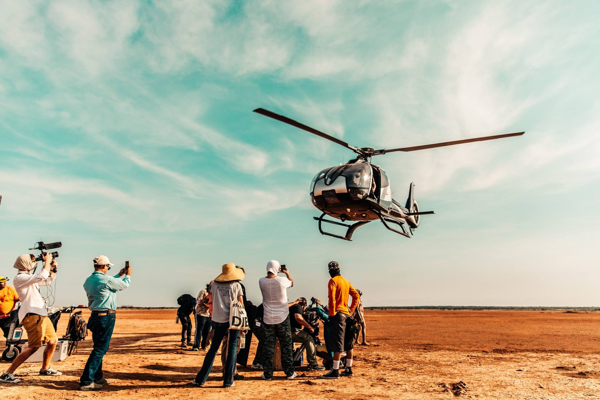 Filming in the desert, woefully unprepared for the dust kicked up by the choppers.  Photo credit: Yasha Malekzad