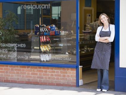woman-standing-doorway-restaurant-smiling-5940426.jpg