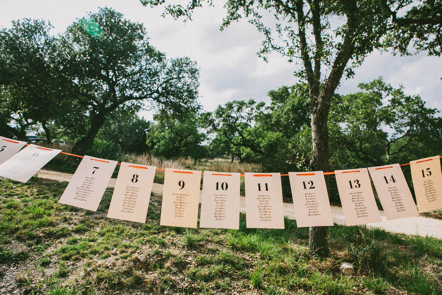 Table Seating on a String   Home Ranch Wedding   Lisa Woods Photography