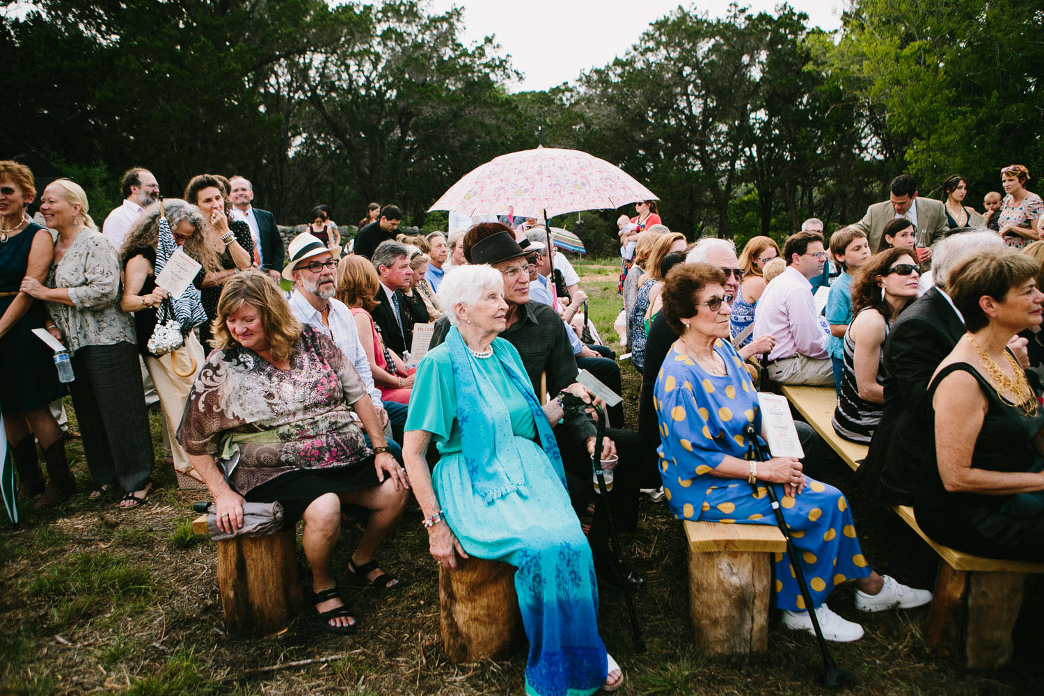 Wedding Guests on Homemade Pews   Home Ranch Wedding   Lisa Woods Photography