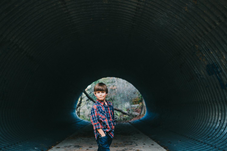 Boy with Smirk   Walnut Creek Park Austin, Texas   Lisa Woods Photography