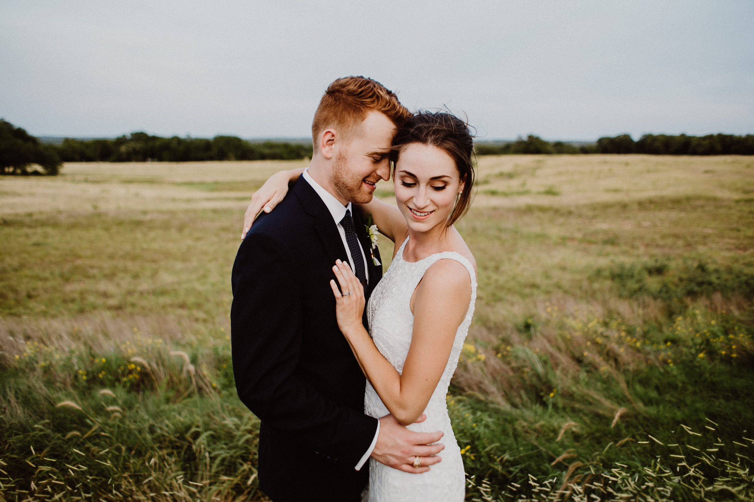 bride and groom in the field at prospect house