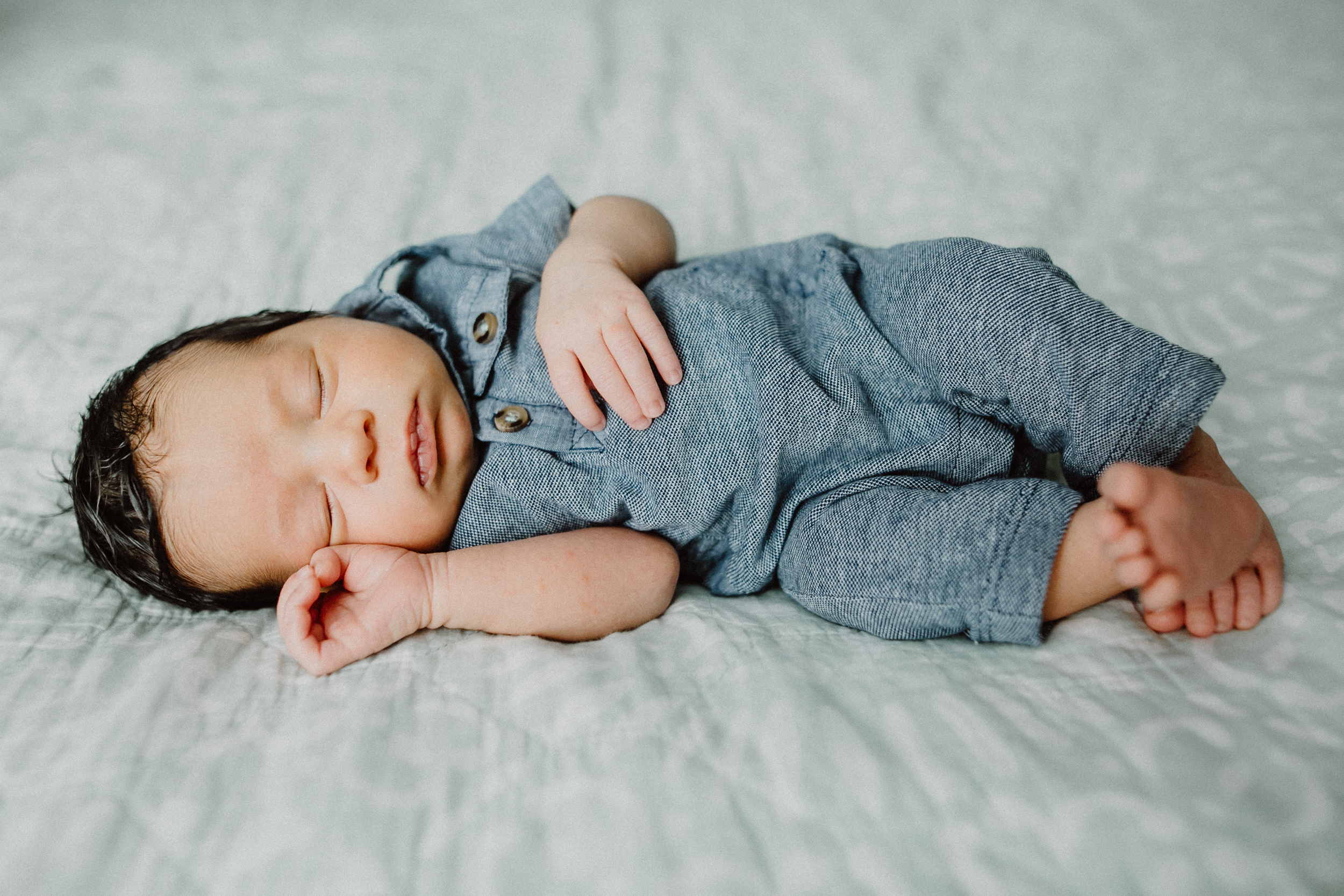 newborn baby on bed in austin