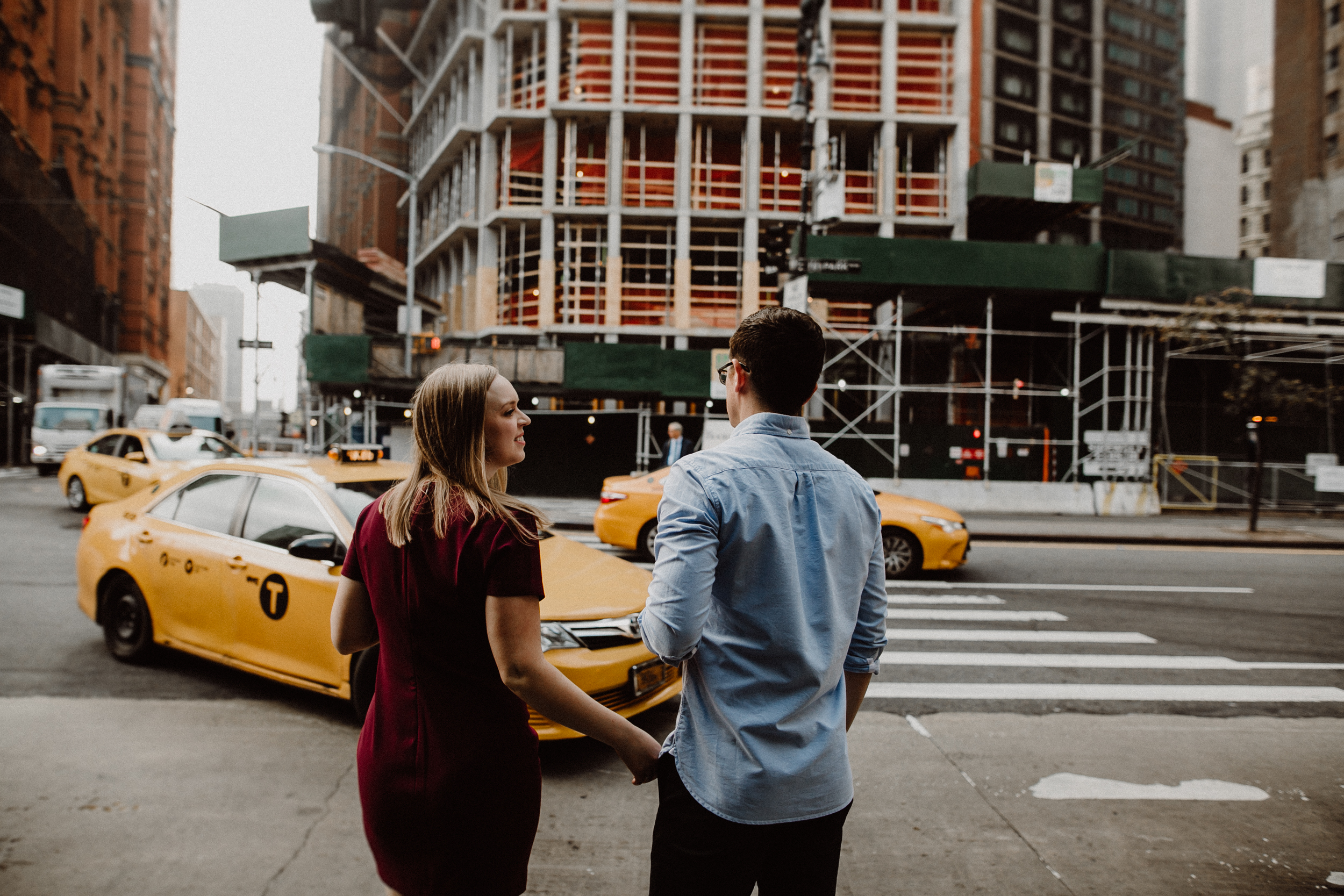 new york couple walking to get a cab