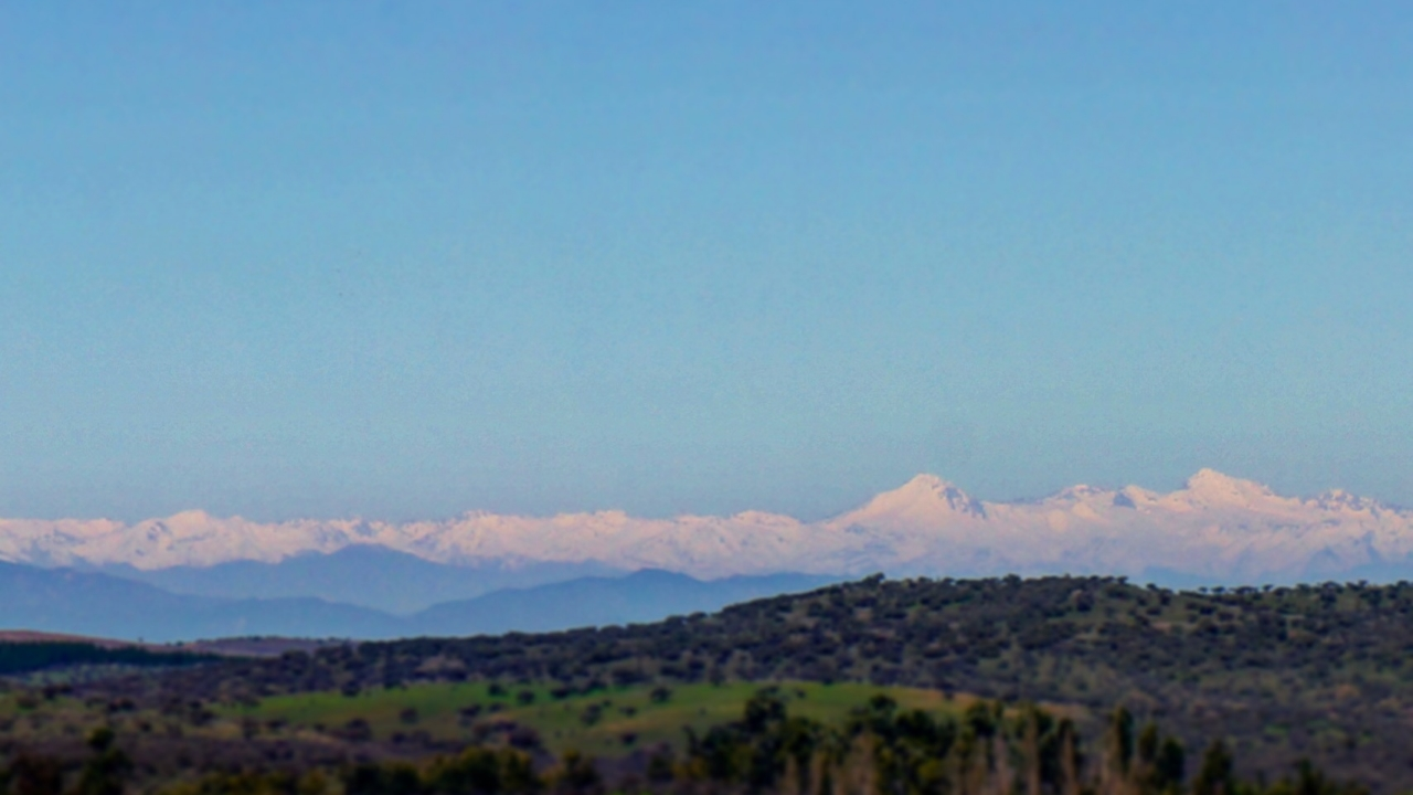 Volcanoes Planchon and Peteroa seen from the road to Pichilemu, on the coast of Chile, 100-miles away.  You know it's big when you can see it from 100-miles.