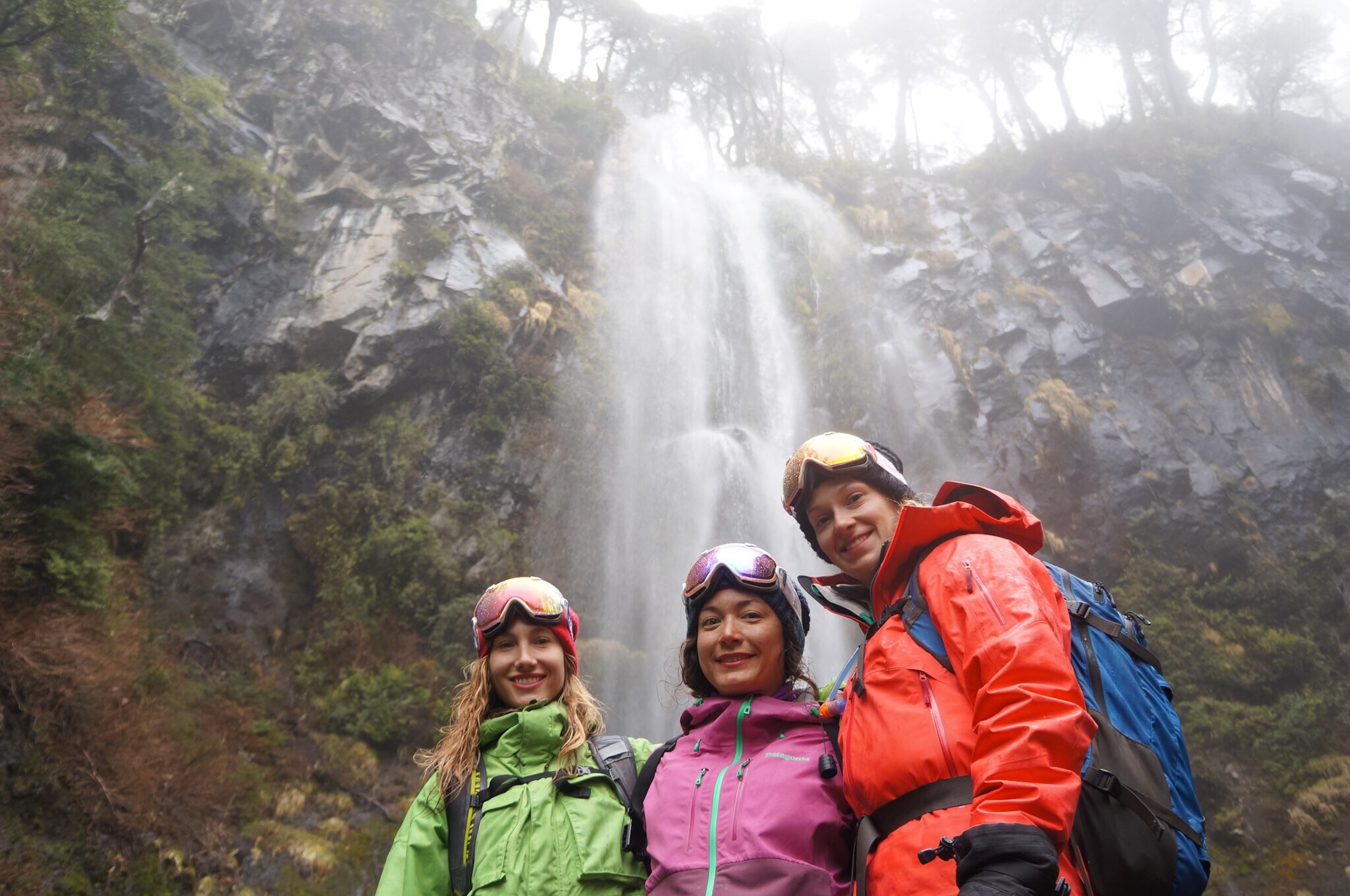 Checking out a waterfall on a wet day in the Andes.