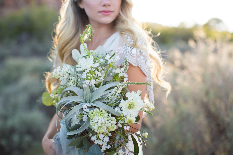 organic bridal bouquet of tillandsia, allium, scabiosa and allium