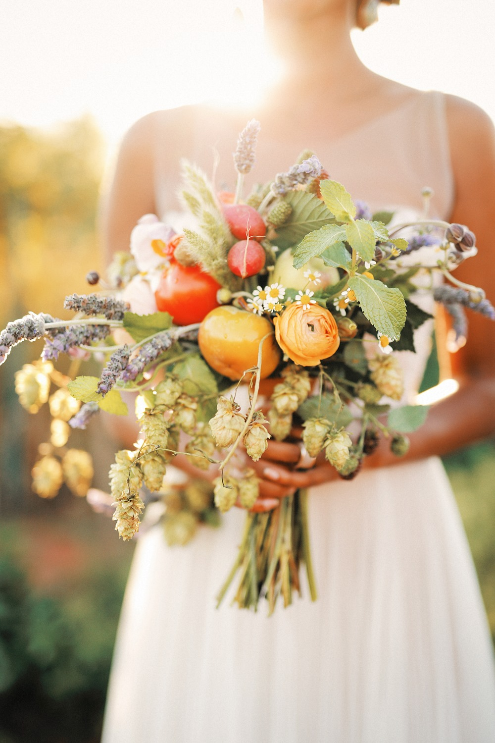 organic bridal bouquet with lavender, hops, ranunculus, radishes and heirloom tomatoes
