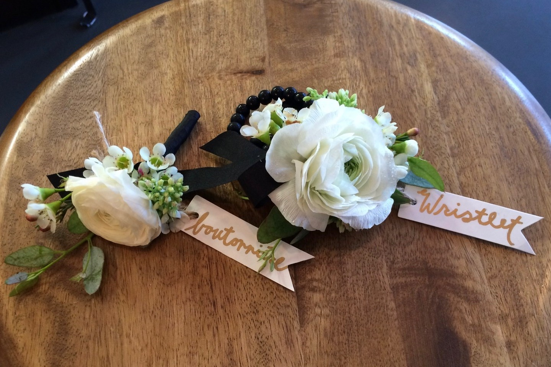 white ranunculus wristet and boutonniere