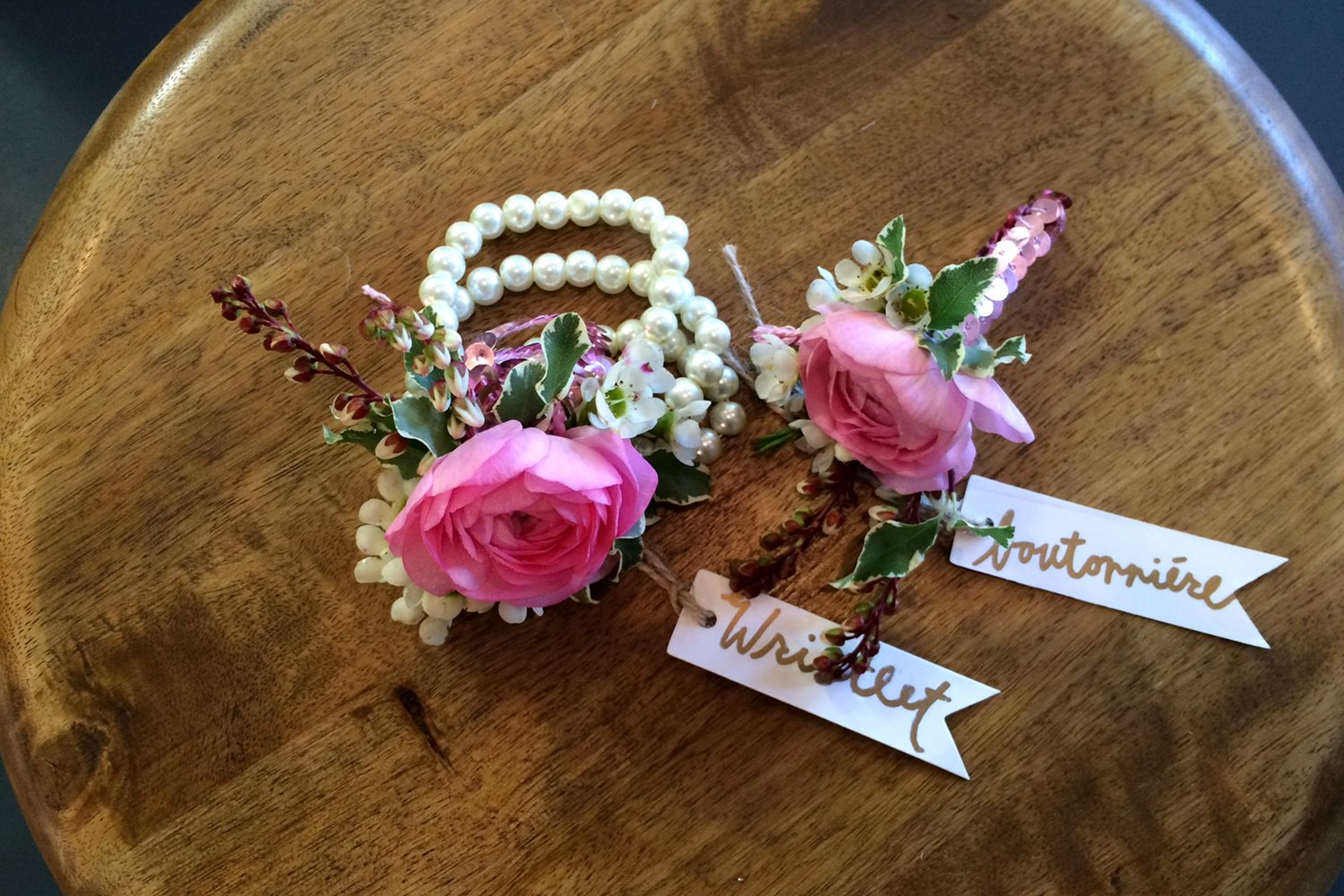 pink ranunculus wristlet and boutonniere