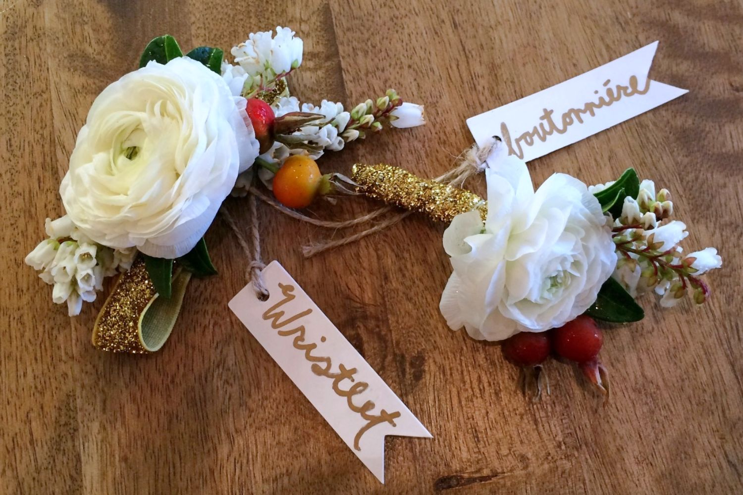 white ranunculus wristlet and boutonniere