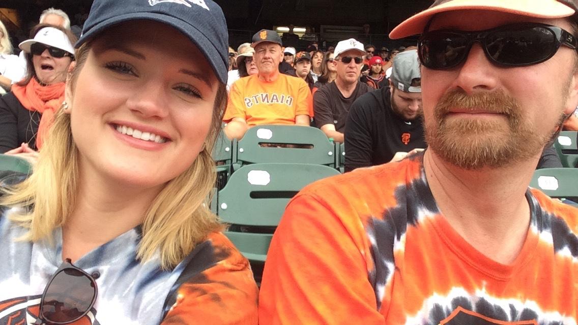 Wicked good seats in killer tye-dye shirts. Go, home team!