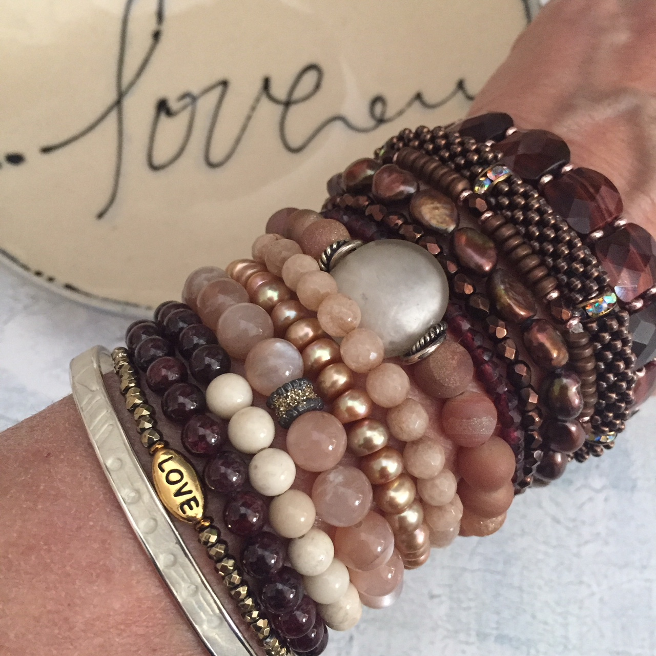 2/14 is all about love in all it's subtle shades and splendor. Dusty rose, blush and beige, russet and rouge, garnet, copper, moonstone, drouzy, polished fossil, dyed pearls, red tiger's eye, pink gold, and agate are stacked to express.  Sharing the love!
