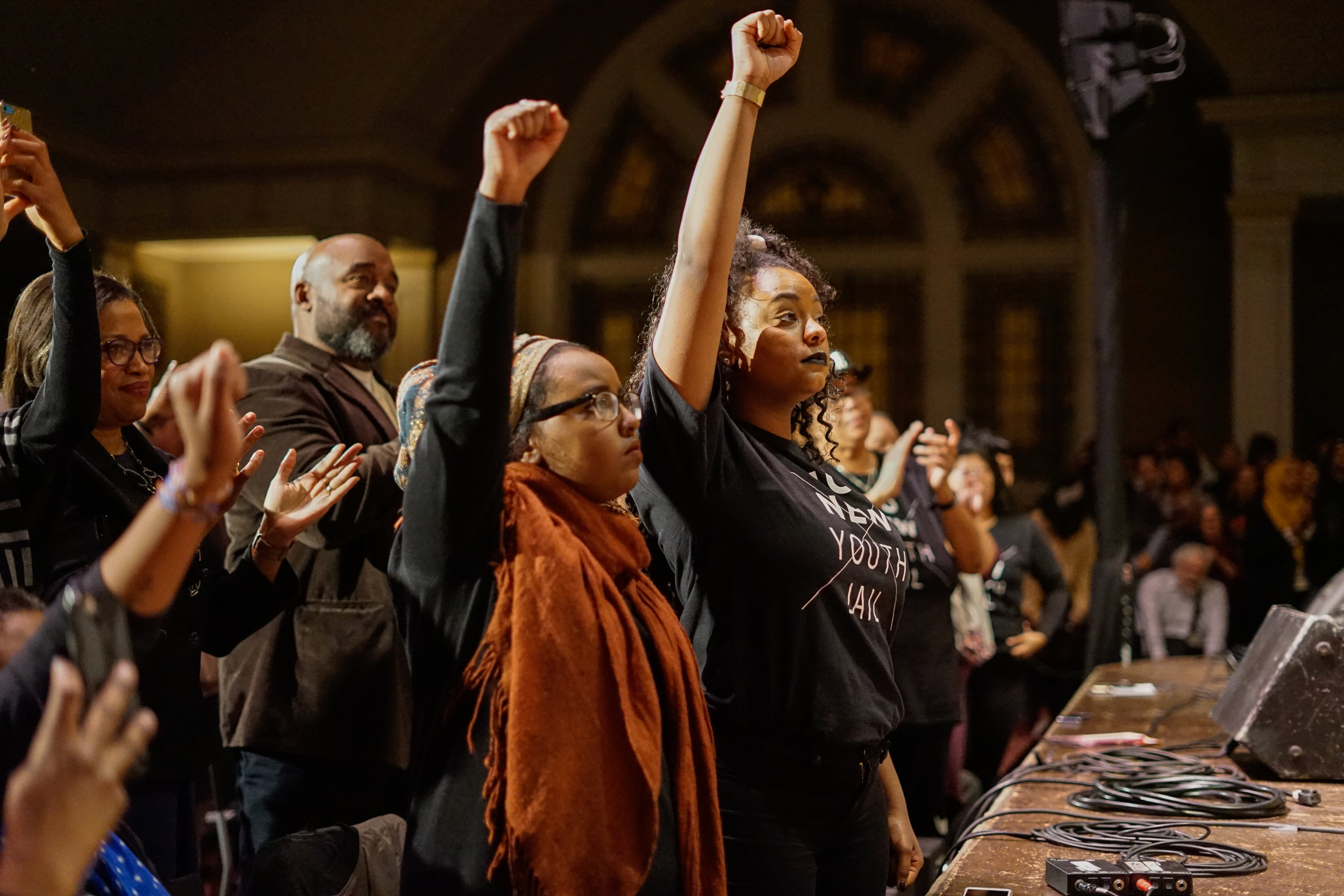 No Youth Jail activists raise their fist in support of Angela Davis' opposition to mass incareration.