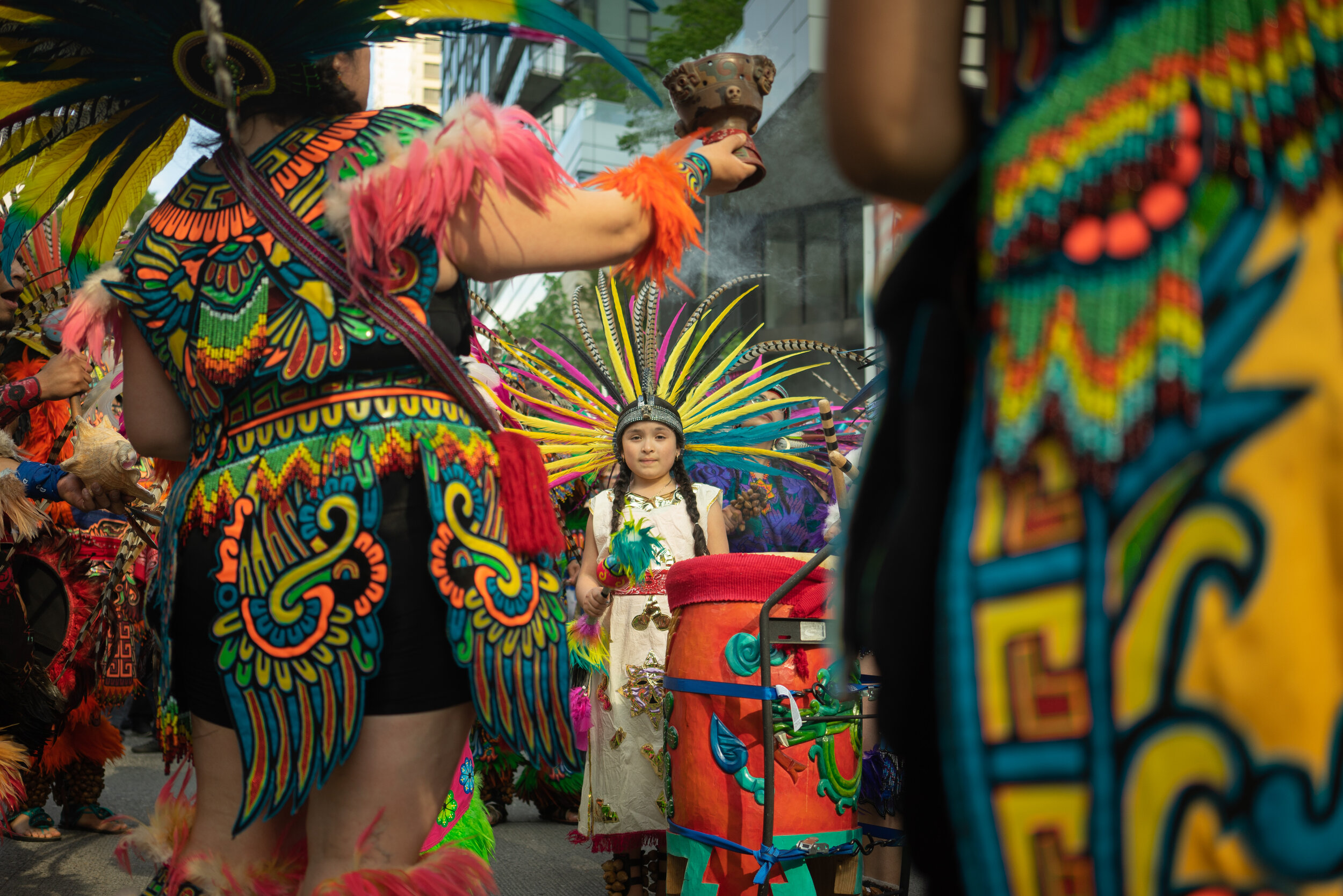 The youngest member of  CeAtl Tonalli , an Aztec dance troupe, leads the annual May Day rally for worker's rights.