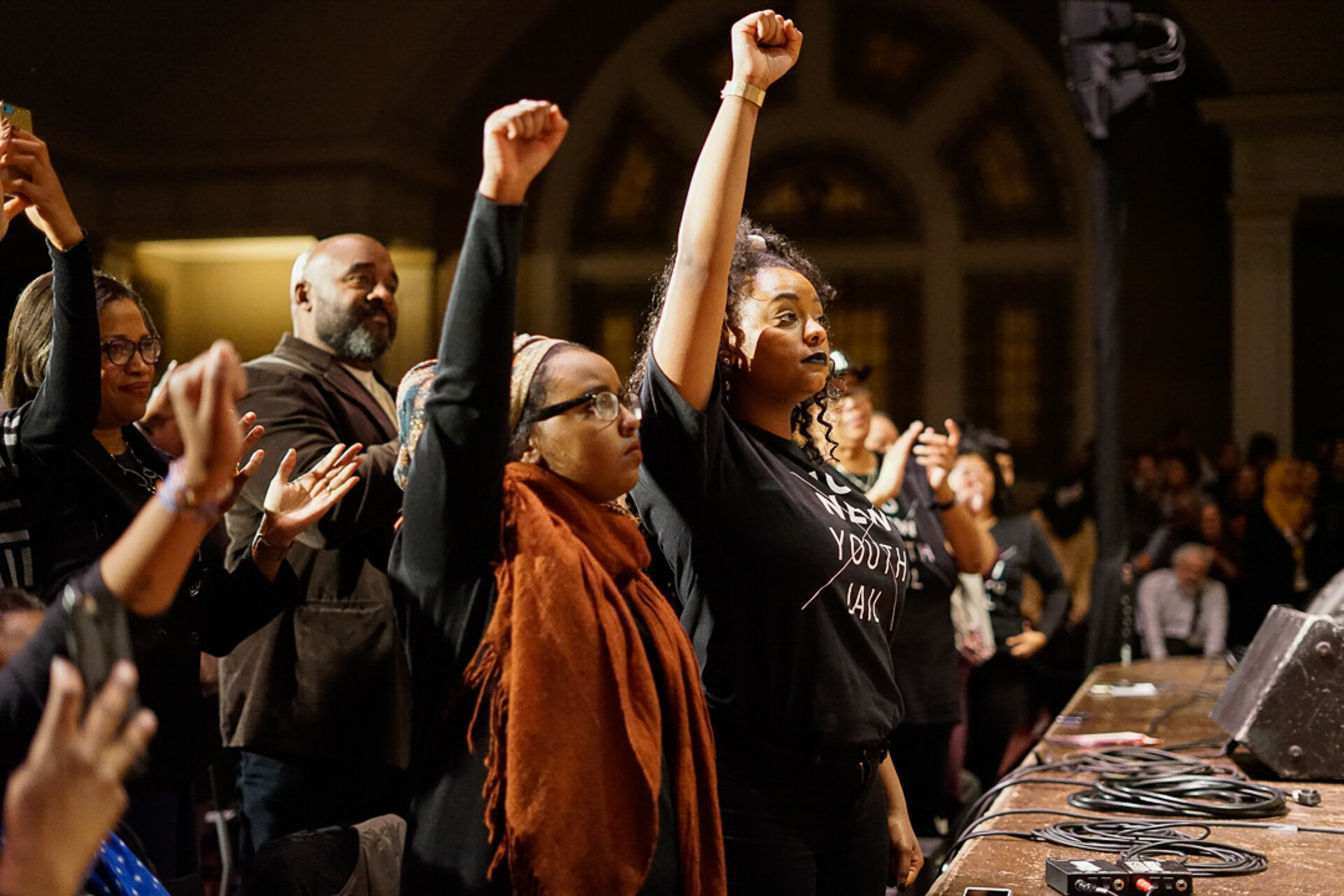 'No Youth Jail' activists raise their fist in support of Angela Davis, who's talk in Seattle touched on her opposition to mass incarceration.