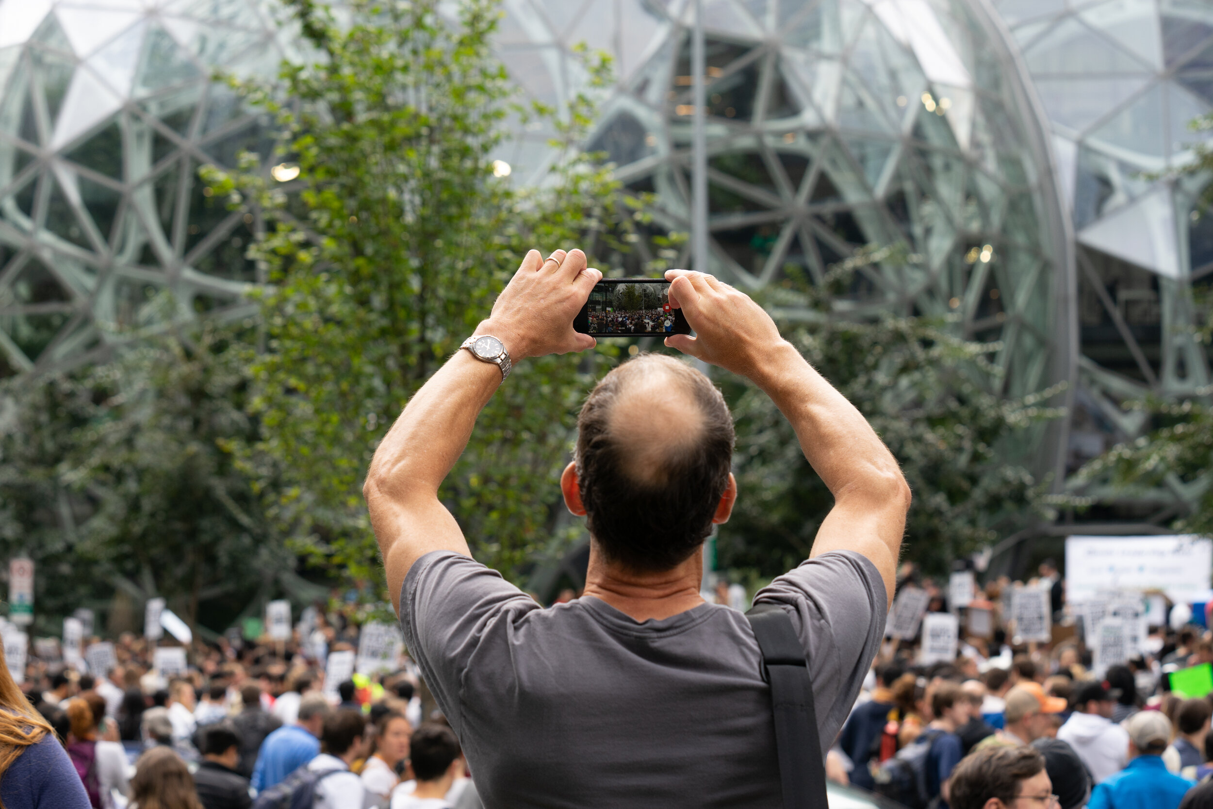 An Amazon.com Inc. Employee take a photo of the crowd outside the company's headquarters during the Global Climate Strike in Seattle, Washington, U.S., on Friday, Sept. 20, 2019 (Bloomberg)
