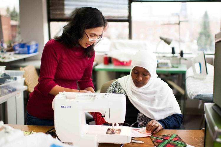 Refugee Teacher and Woman Sewing