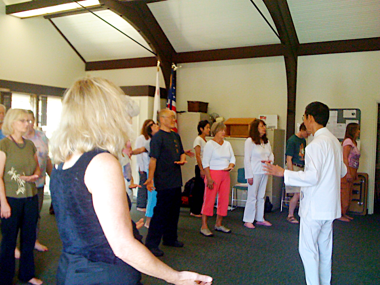Chiyan's father (on right, in white) teaching Taoist Light Qigong