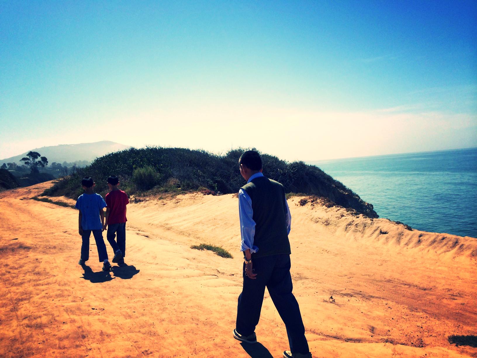 father walk along coast.jpg