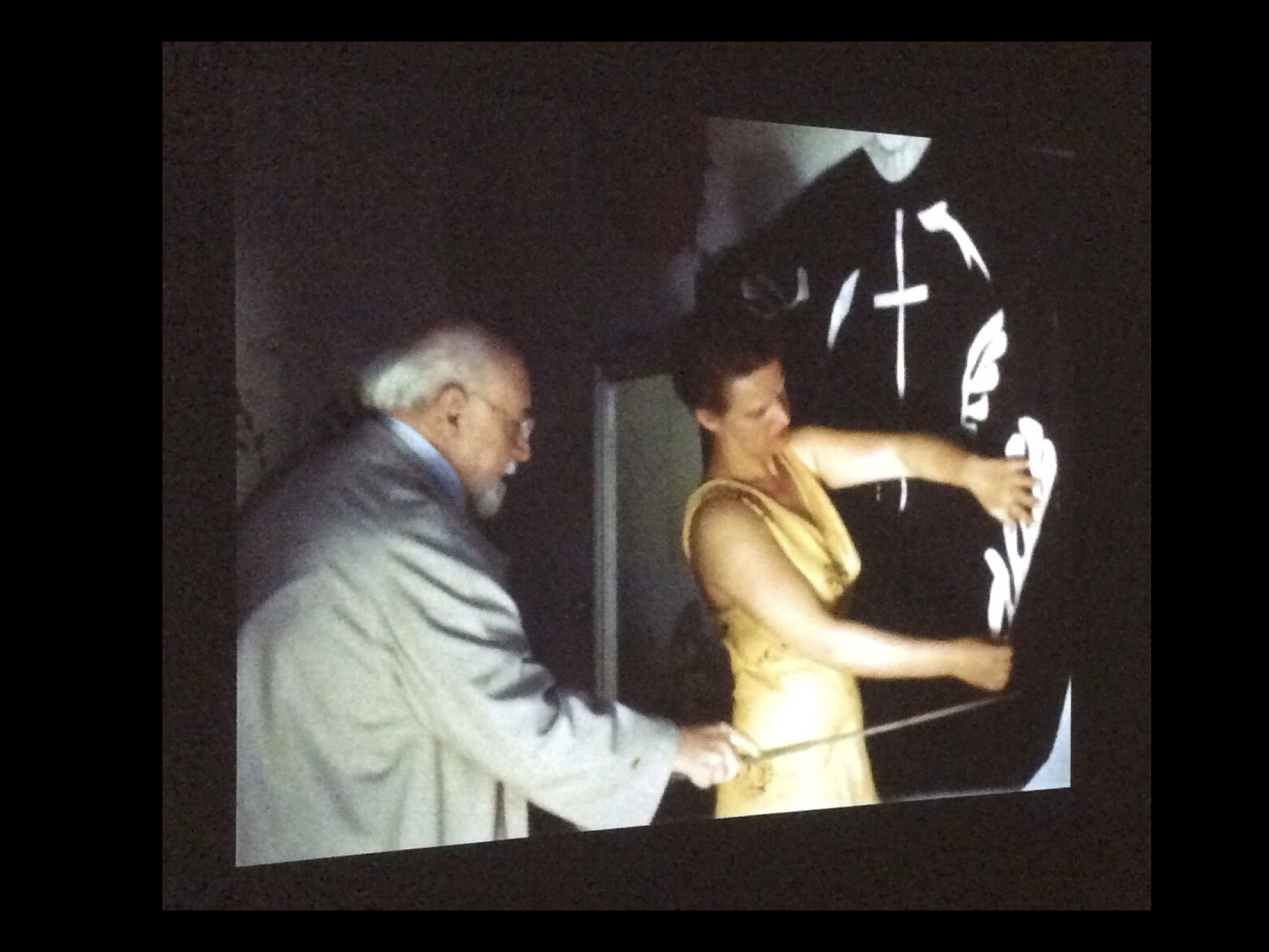 This is still from a documentary shown in a Dutch museum, showing Matisse working with one of his studio assistants. As he got older, Matisse often worked with assistants to physically help him with larger works. He told his assistants what to do. It was his work. His assistants' hands might be helping him, but he was the artist - negotiating with materials, being happy, and frustrated, and annoyed, and excited.