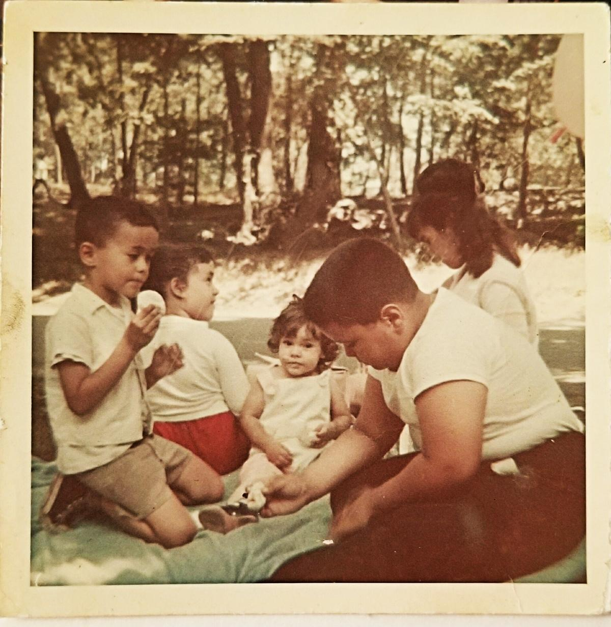 My Family @ NYBG 1965 - As a child, the New York Botanical Garden (NYBG) would allow picnics on the premises. I recall sharing family meals, playing, scraped knees and even eating a daisy or two.Foto taken by my Mother Hilda Irizarry, Sr. with a Rolieflex TLR.At Center - Xposure Artisan age 16 months.