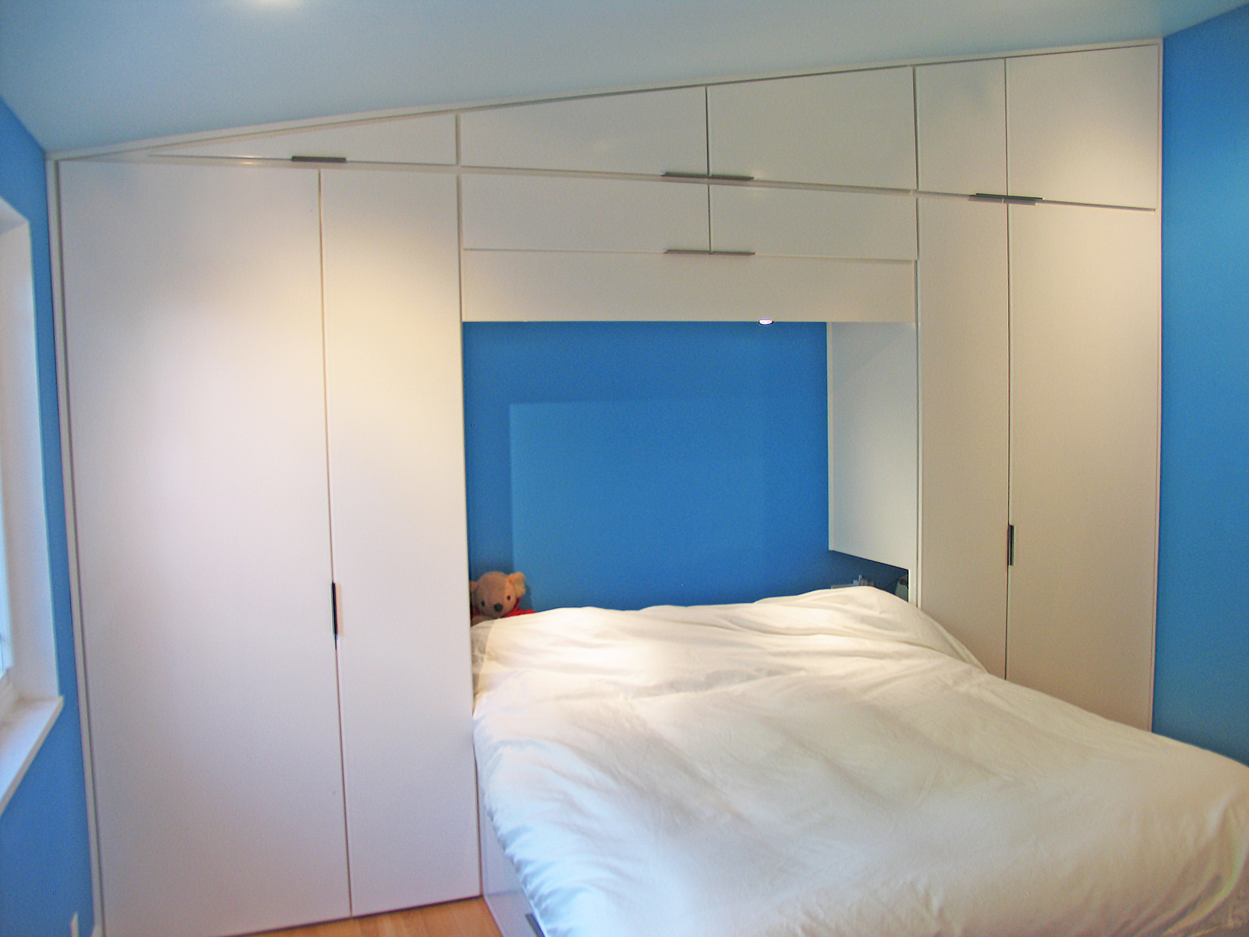 Built-in bedroom closets and bed