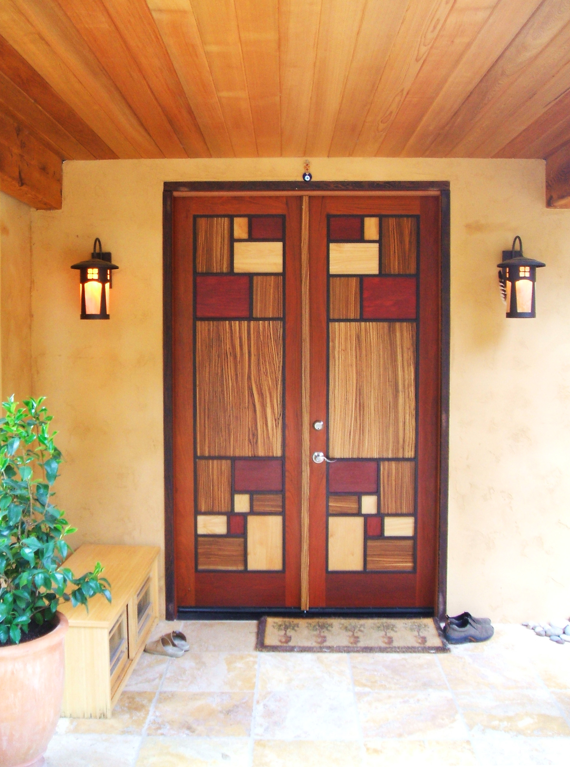 Front entry doors in 5 exotic woods: Jatoba, Wenge, Zebra, Purple Heart, and Curly Maple