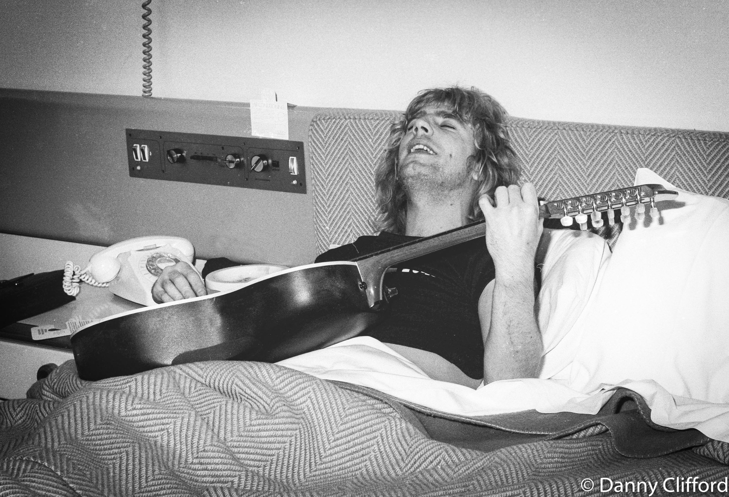 I had some of my best times on the road with Status Quo. Here is one inebriated Rick Parfitt in his hotel bed singing away. I think this was The Albany Hotel, Glasgow, Scotland.