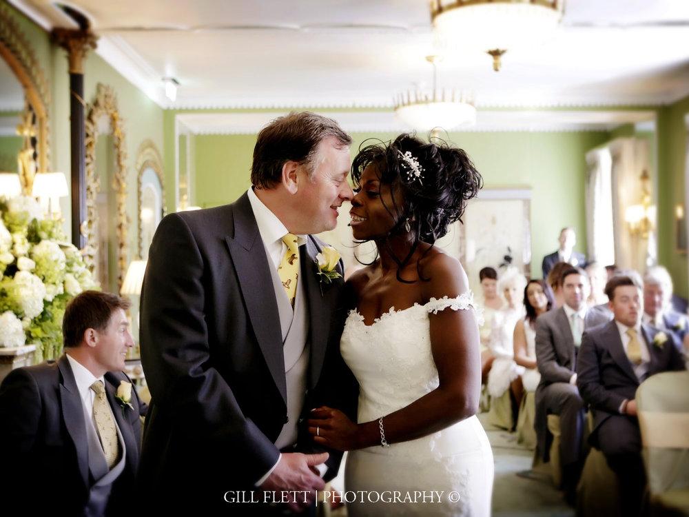 dorchester-first-kiss-mature-interracial-summer-wedding-gillflett-photo-london.jpg