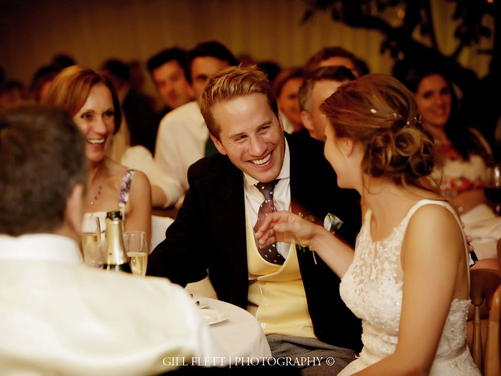 bride-groom-laughing-marquee-summer-wedding-gill-flett-photo.jpg