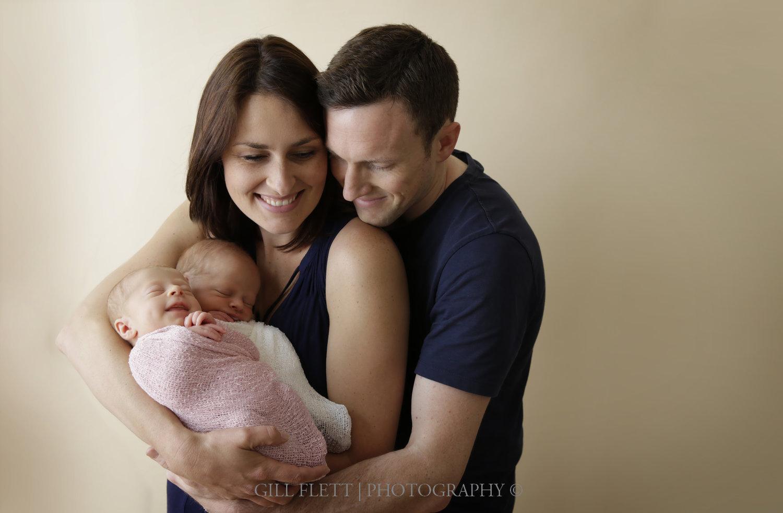 fraternal-twins-smiling-parents-arms-gillflett-london.jpg
