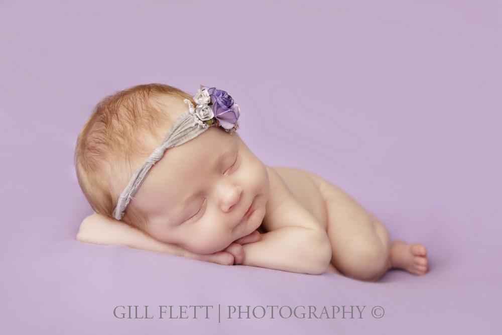 newborn-side-pose-lavender-background-tieback-gillflett-london.jpg