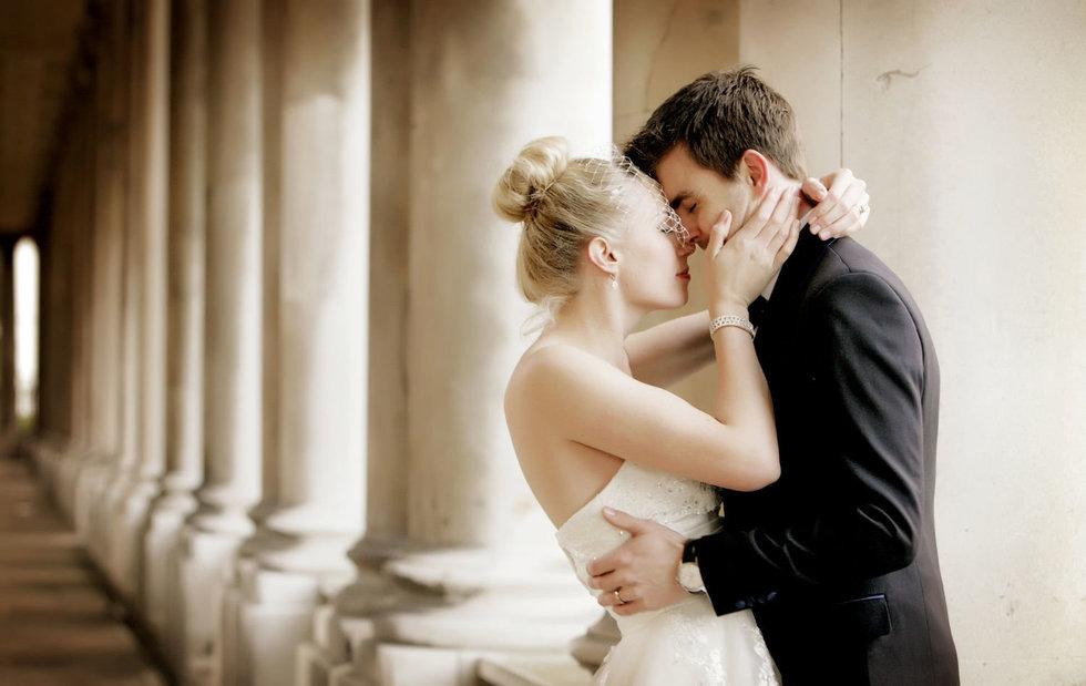 london wedding photographer pillars bride and groom