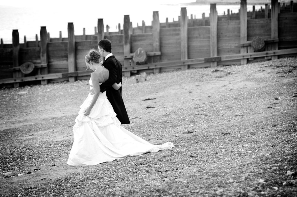 eastbourne wedding photographer beach bride and groom black and white