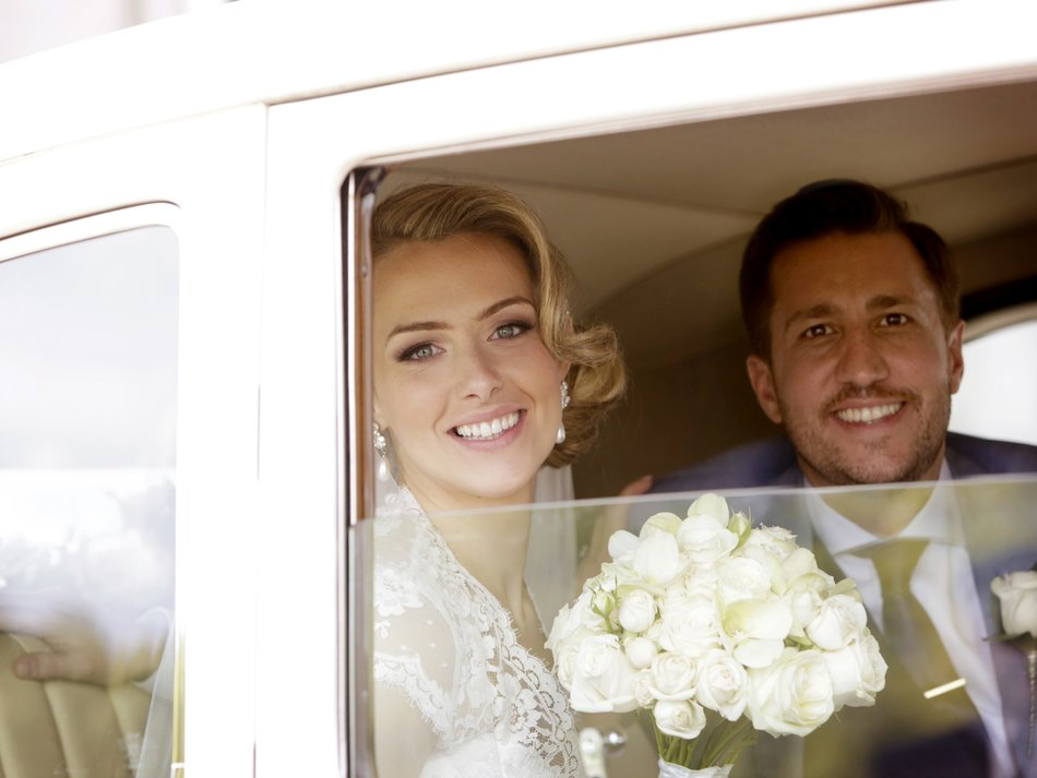 london wedding photographer bride and groom car