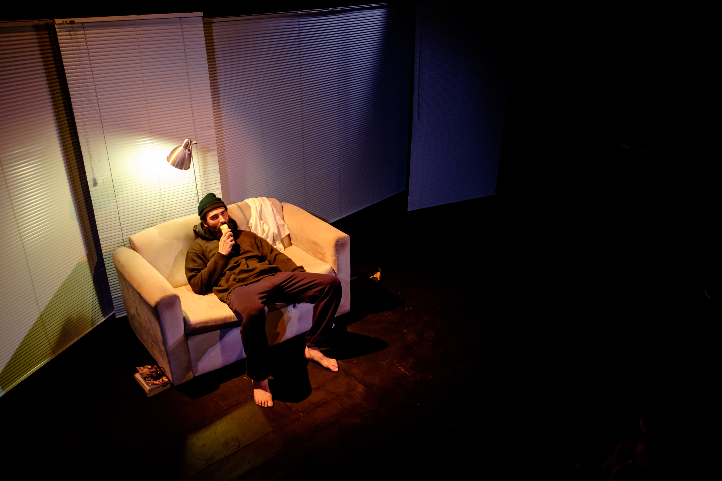 """""""What we see here is not naturalism. It is heightened reality. [...] Lara Week's set achieves the necessary trapped-in-stasis feel, using nothing more than Venetian blinds and a couch.""""   —Review, Stage Whispers"""