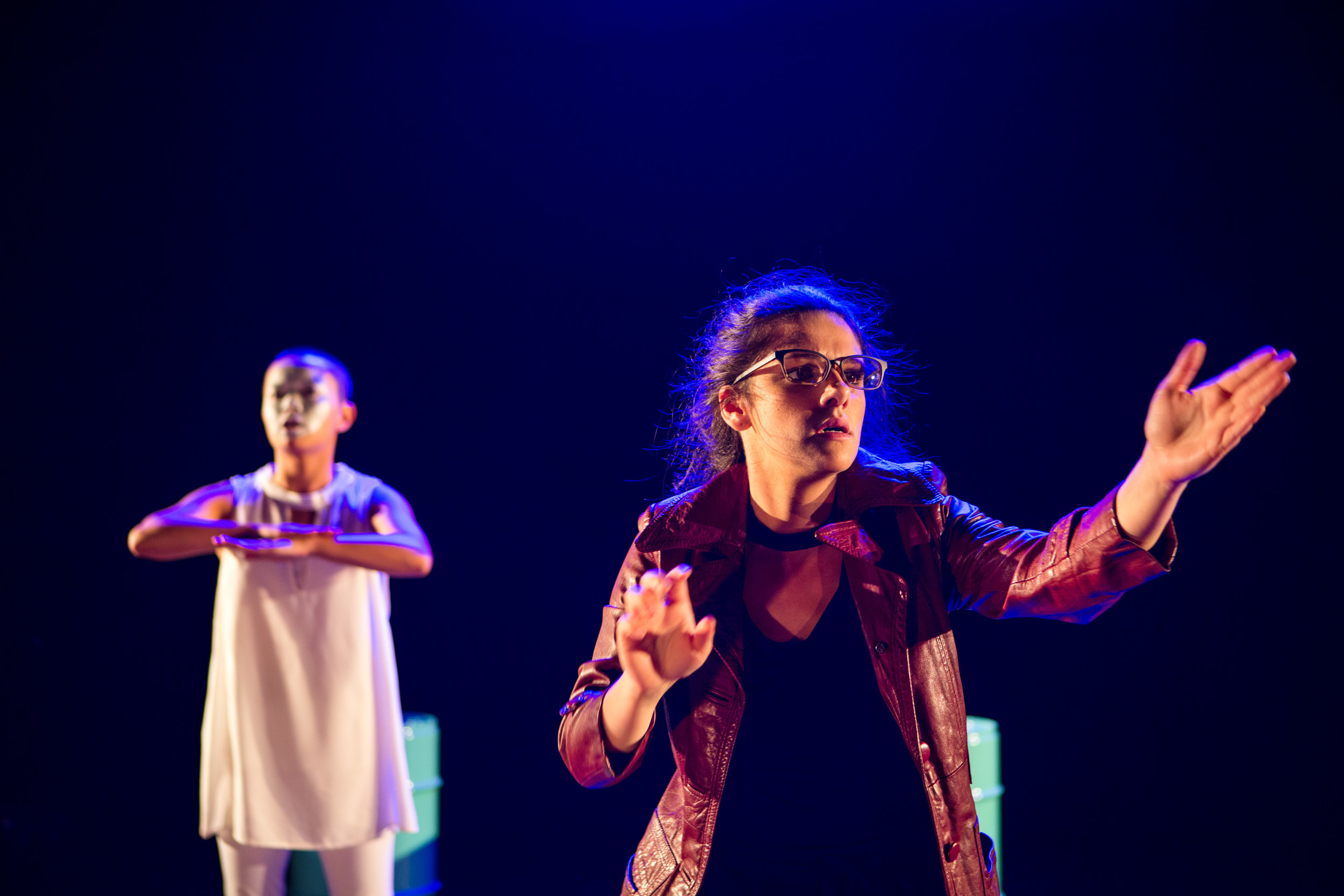 """""""Yet another bright and adaptable space [by Lara Week]. Turquoise cylinders serve as podiums, seats, towers, and the ever-present reminder of man-made waste."""" — Review, Theatre Press"""
