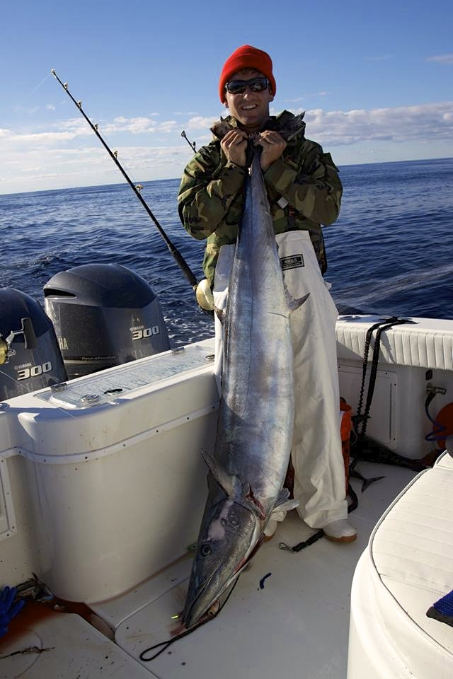 Tim Cohan with a monster Wahoo caught on one of our stand up rods in the North East canyons