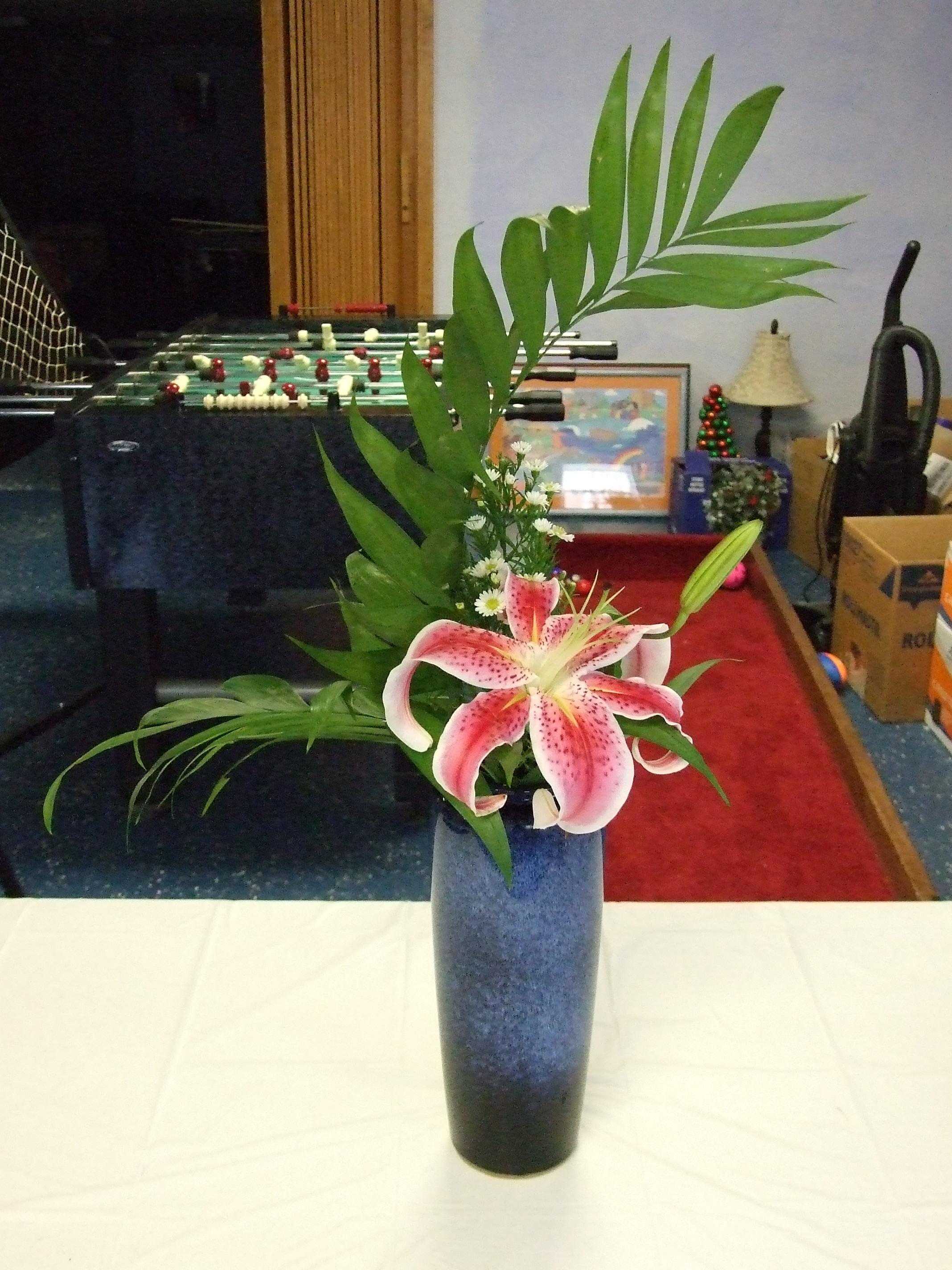 Palm, Star gazer lilly, white aster.
