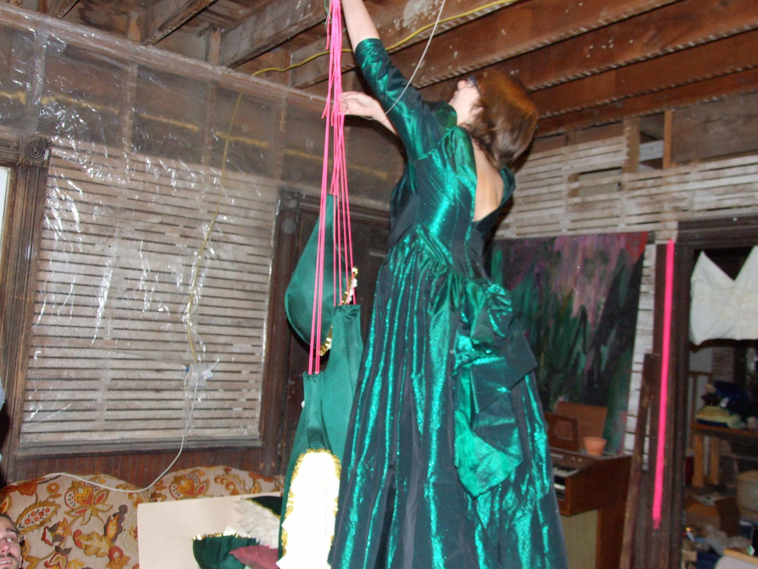Hanging Jawbone sculptures in my fancy green dress.