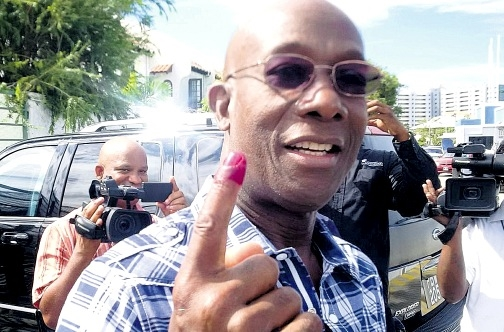Dr Keith Rowley poses for the cameras moments after casting his vote on September 7th, 2015.
