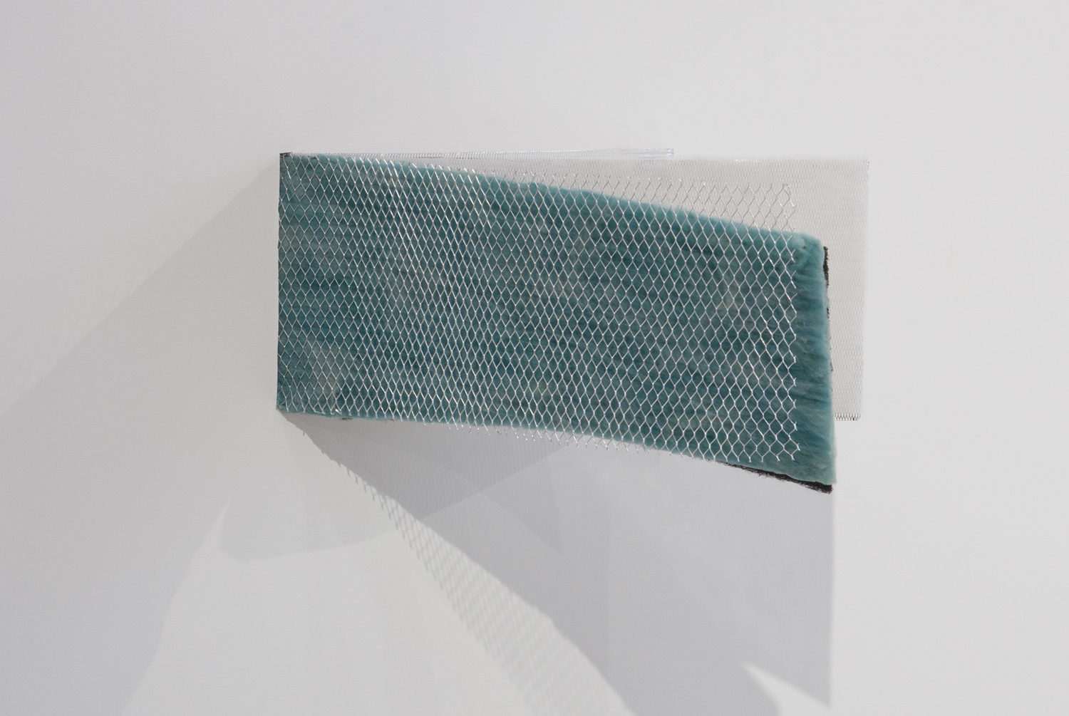 Unmeshed Odor Trap  , 2014.Carbon coated polyester, metal mesh, fiberglass, uncoated polyester