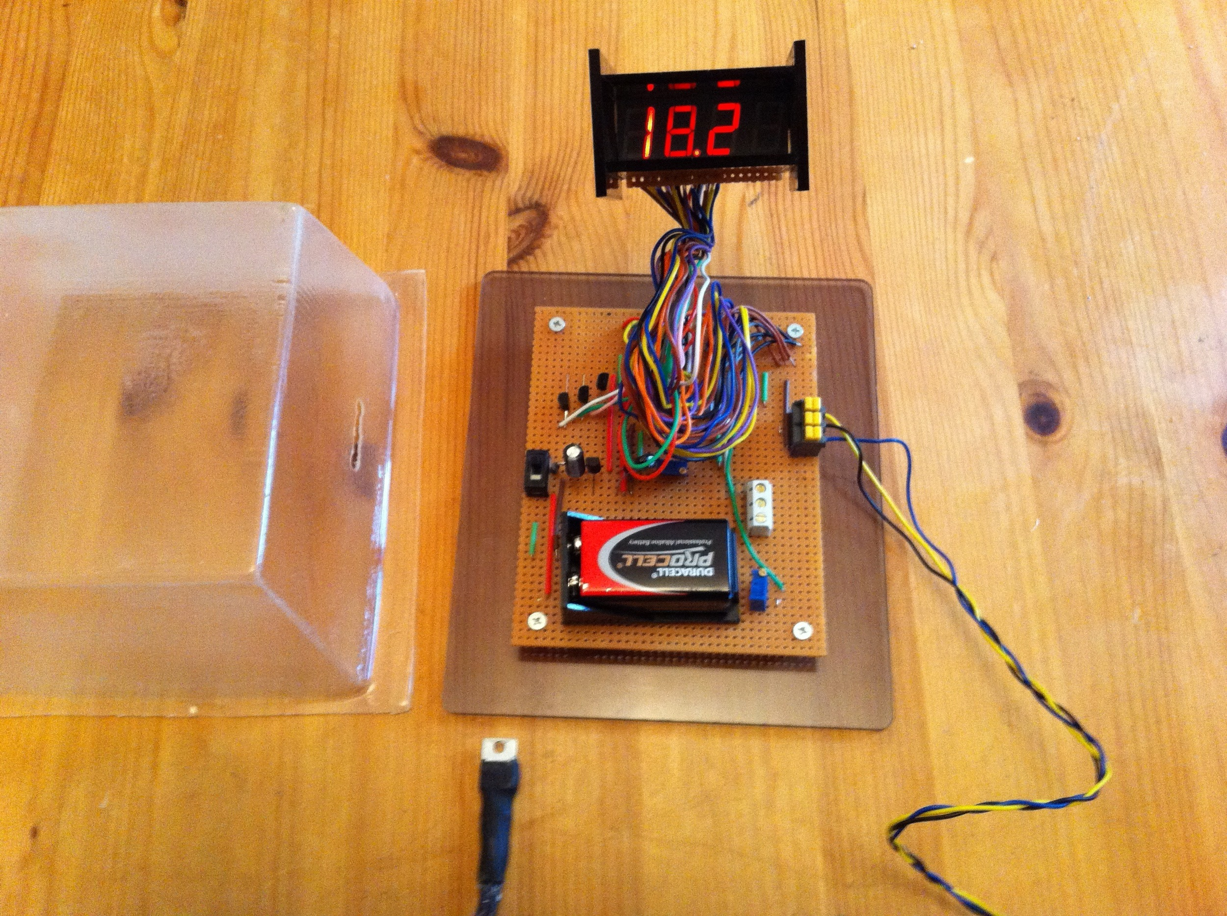 The thermometer utilsed an LM35 temperature sensor and a 7 segment display. The clear cover was vacuum molded.