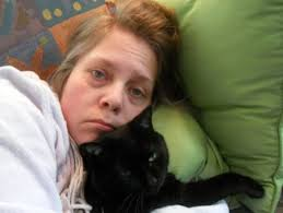 sick person and cat