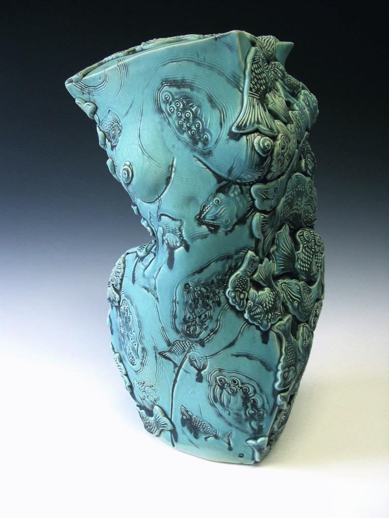 1. Turquoise Figure Vessel.jpg