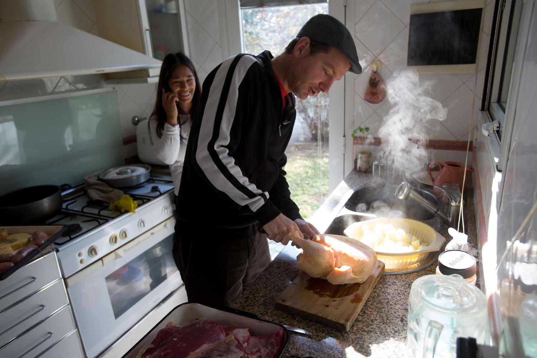 Man Prepares Chicken, Argentina