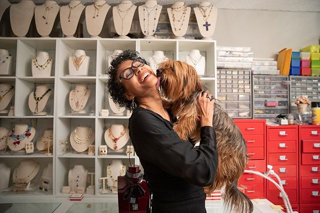 Alzerina - 2019, Upper East Side, with her dog Kyko in the design studio of her apartment. While living in Paris, she learned the craft of jewelry making, and in 2005 started her own jewelry design company - Alzerina Jewelry. Her designs have been worn by pageant winners and celebrities, including @sharonstone and @oliviawilde. * * * * #99snapshots #manhattan #nyc #canon5dmarkiv #documentary #nycpeople #newyorklife #ig_nyc  #people_infinity  #manhattan #entrepreneurs #dogsofinstagram #dogsofnewyork #instadog #designerdog #fashiondog #doggo #fashion #jewelrydesign #alzerina @alzerinajewelry #capeverde #nycstyle #missuniverse #missusa @seanc74 @mossvanishingnewyork #powerwoman #immigrant #thenandnow #documentaryfilm